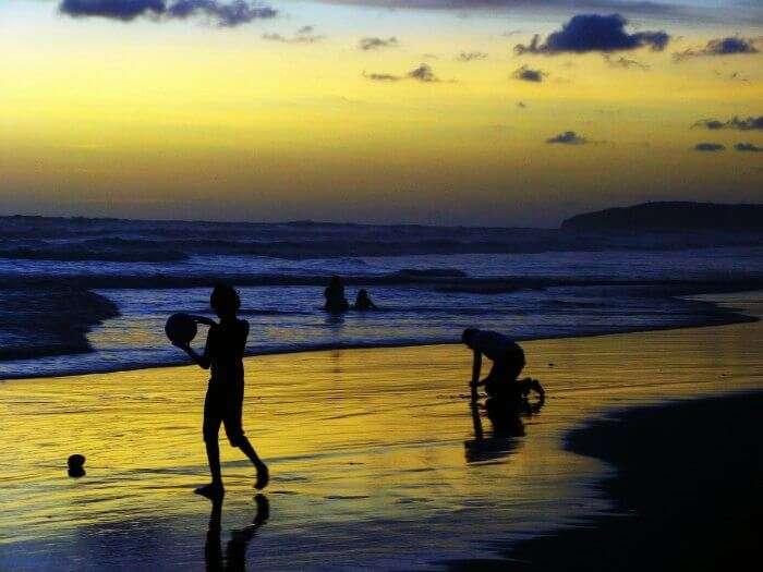 People playing at Ganpatipule beach in Maharashtra