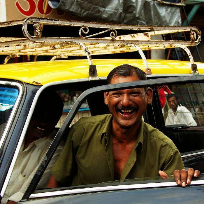 Happy taxi river in Mumbai
