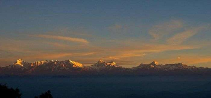 The remarkable view of Himalayan range with the first ray of sunshine from Kausani