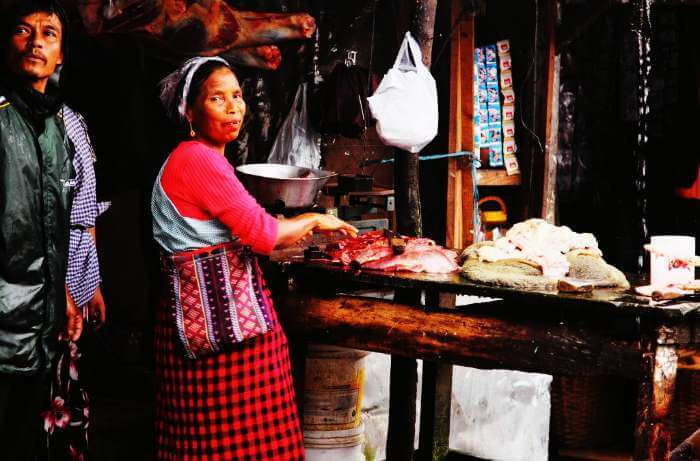 A Khasi Woman working as a butcher