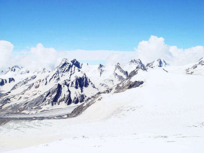 Stunning view of the snow capped peaks and hanging glaciers in Khatling