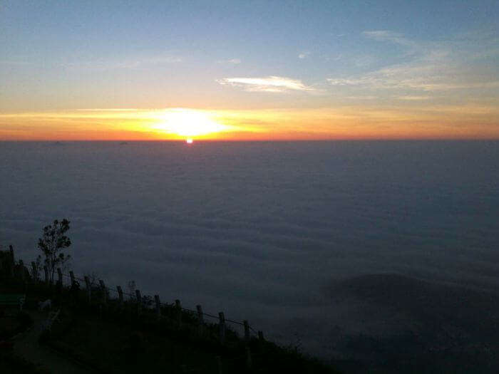 The misty sunrise in Nandi Hills
