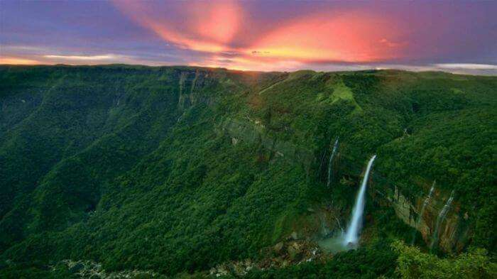 The vivid sunrise at Nohkalikai Falls in Cherrapunji