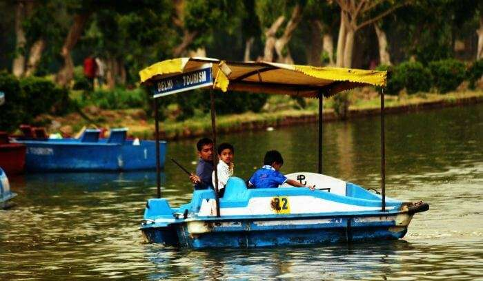 Paddle boating in a lake near one of the best picnic spots in Delhi - India Gate