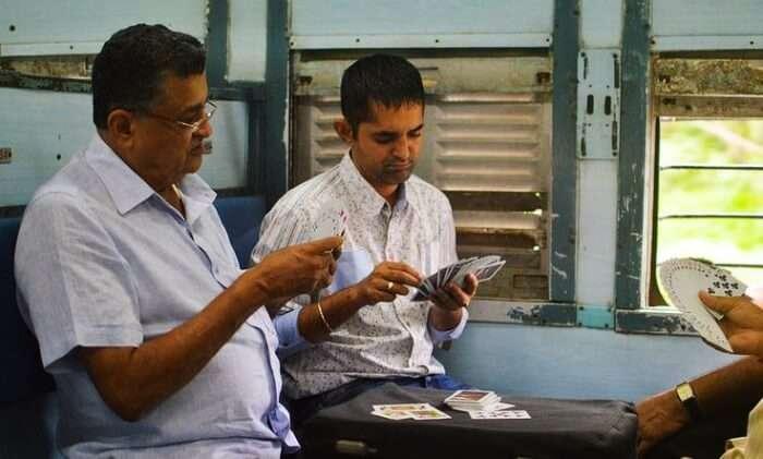 Passengers playing cards in Mumbai Local