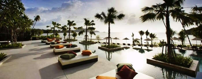 The picturesque poolside views of Radisson Blu Plaza in Phuket during sunset
