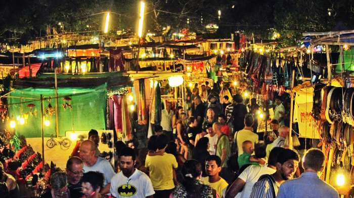 Go for shopping at Saturday night market at Arpora