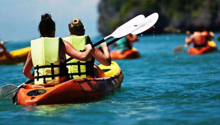Sea kayaking in blue waters of Mauritius