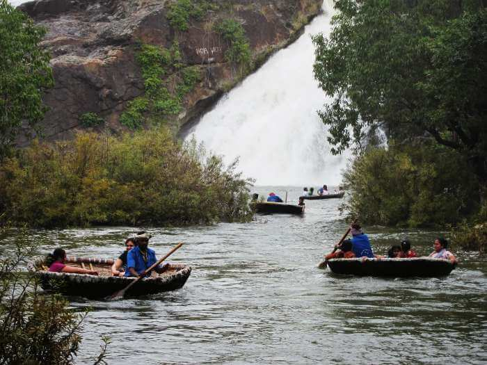 Tourists enjoying a coracle ride in Shivanasamudra Falls in Mandya