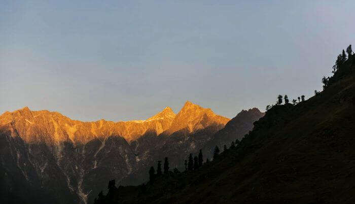 First peek of sun on mountains of Spiti Valley