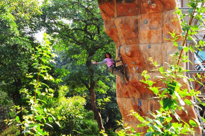 A girl on the sport climbing wall in Indian Mountaineering Foundation in Delhi