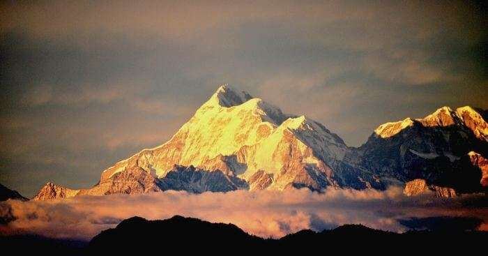 The peaks of Nanda Devi turn golden at Sunset