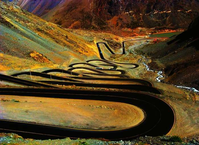 An aerial view of the hairpin bends of The Caracoles, Chile