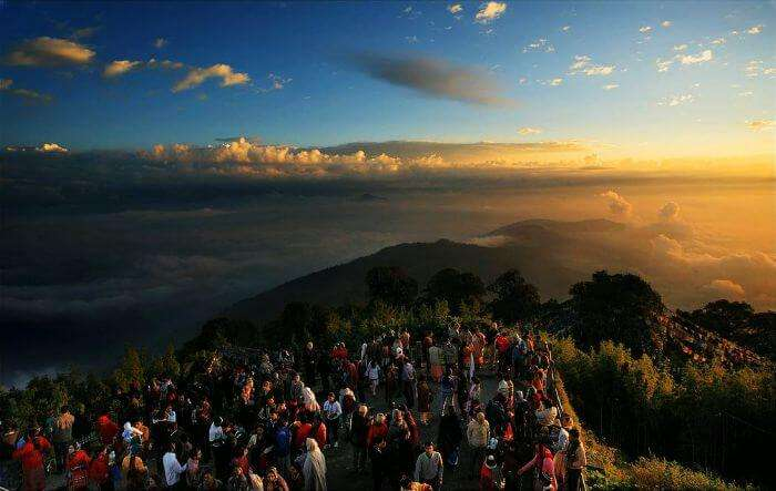 Hundreds of people gathered around to watch the famous sunrise at Tiger Hills in Darjeeling