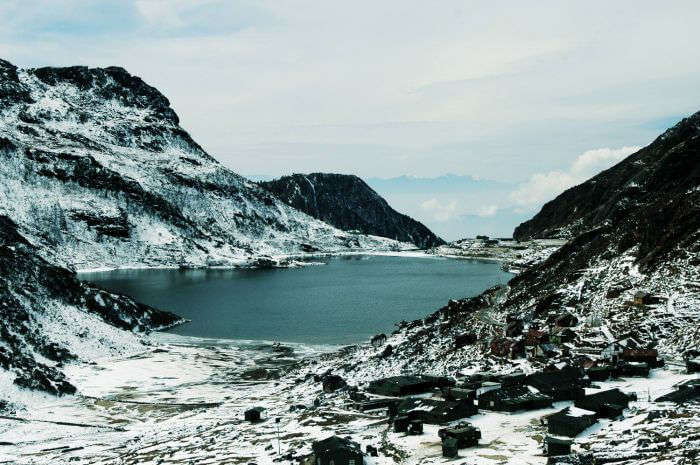 Snow covered peaks surrounding the Tsomgo Lake