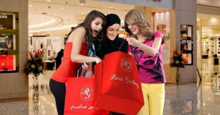 3 young girls enjoying shopping at a mart in Dubai
