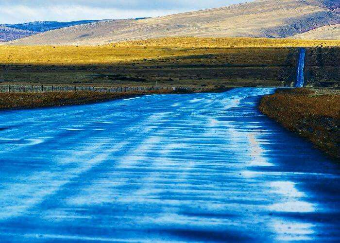 A road in South Chile seems reflective after some rain