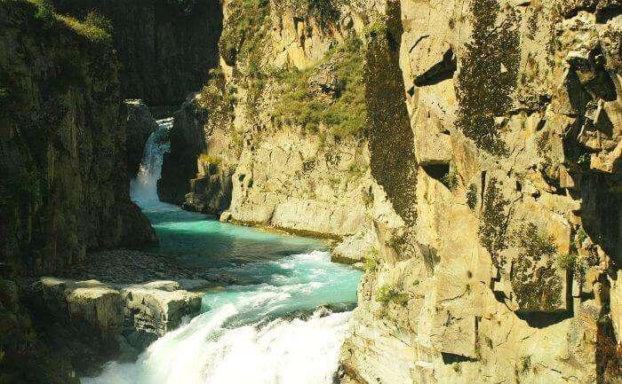 The sun kissed Aharbal waterfall in Kulgam in autumn season