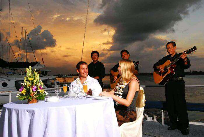 A couple dining at the Bali Hai cruise