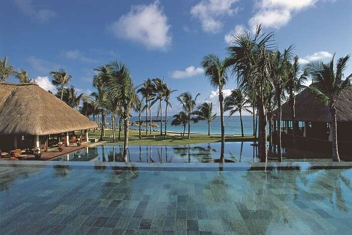 View of serene water villas at Belle Mare Plage - one of the best beach places in visit in Mauritius