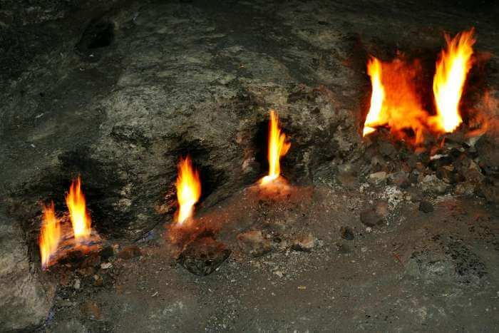 Chimera flames which occur naturally and flicker out of the rock cliff