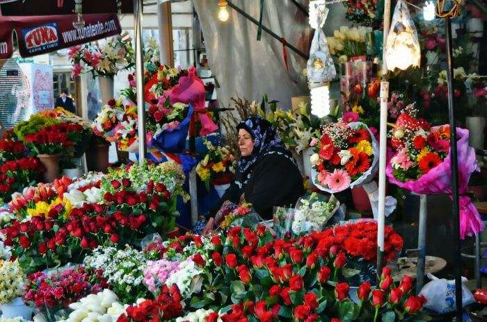 A lady on the stands of Cicek Pazari selling flowers
