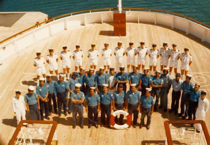 The cruise cabin crew gathers for a group photo before the sail of the ship