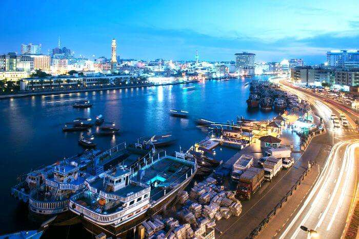 Take an abra ride through the Dubai creek at night to witness the grandeur of the city