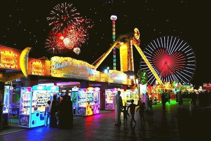 Tourists strolling through the global village and enjoying the Dubai Shopping festival