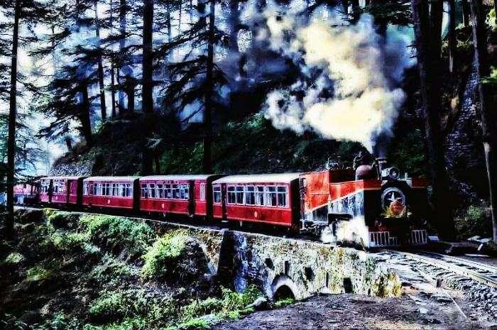 Kalka-Shimla toy train passing through the mountains