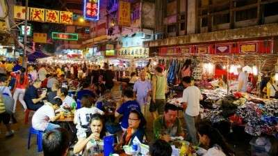 Tourists exploring the night life in Bali with a crazy shopping experience in Kuta Market