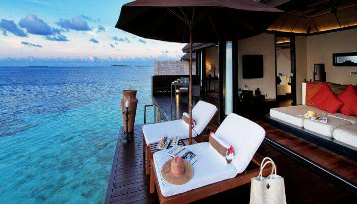 View of the vast ocean and a luxury over water villa at Lily Beach Maldives Resort