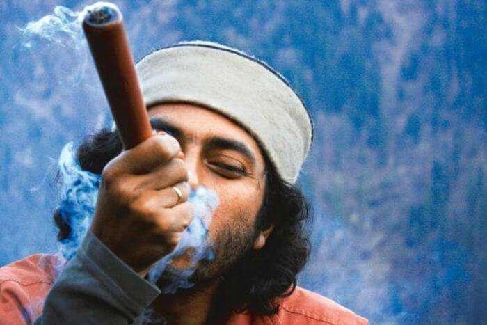 A Malana villager smokes hash