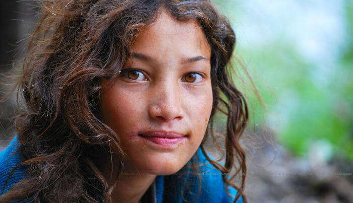 A Malana girl smiles for the camera