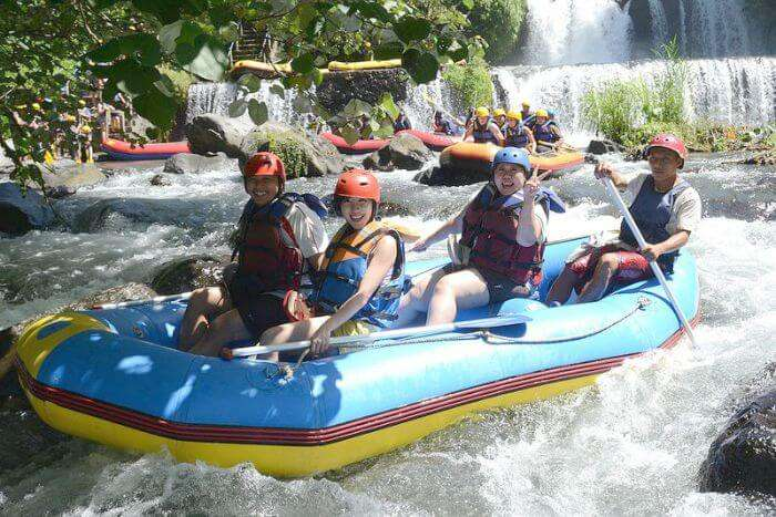 Tourists preparing for an exciting river rafting experience in the waters of Bali