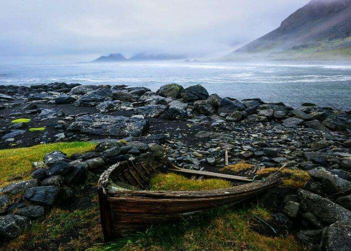Remains of a boat on the beautiful Stokksnes Beach in South East Iceland