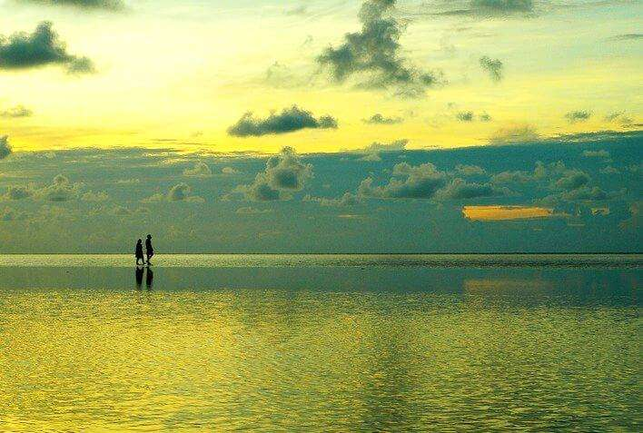 Green hues of a heavenly dusk at the vanishing beach of Chandipur in Orissa