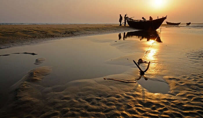 The sea bed is visible as water recedes about 5 km on the Chandipur Beach in Orissa
