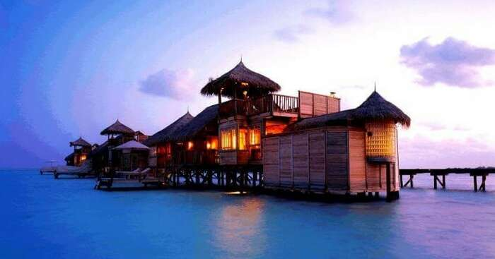 A beautiful view of a water villa during the evening hours in Bali