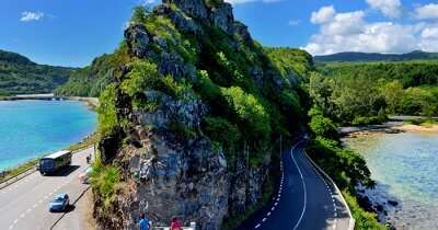 a curvy road in the mountains