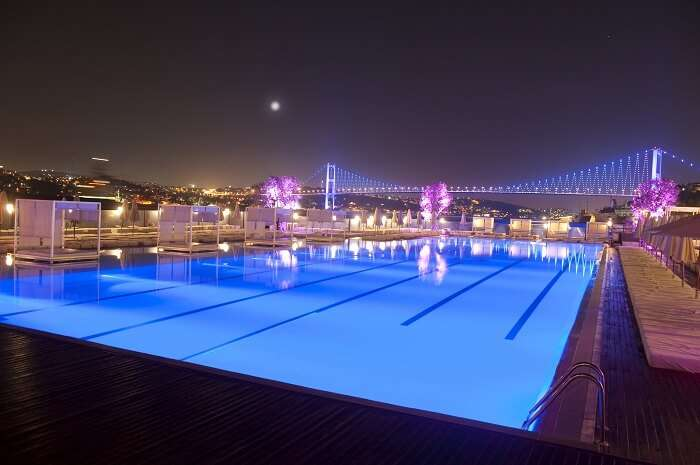 A view of the pool with the Bosphorous Bridge in the background