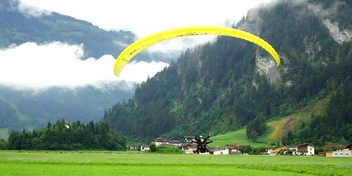 Tourist enjoying paragliding in Manali
