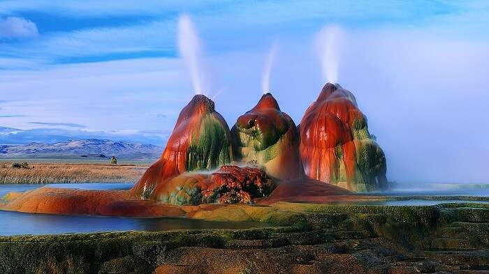 Hot water ejects out of the flying geyser in Nevada