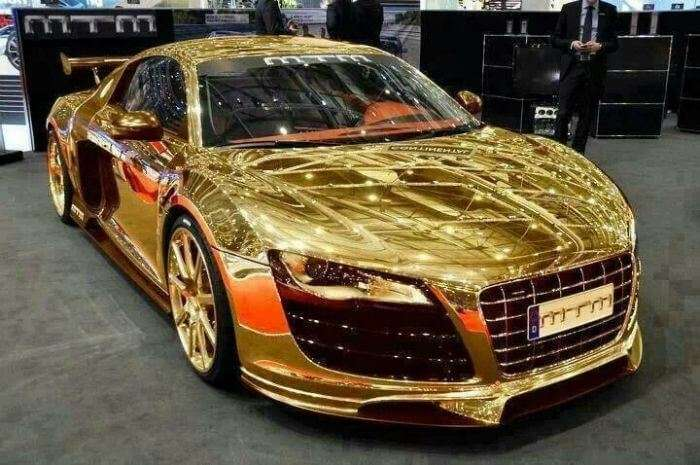 A gold plated boutique car on display