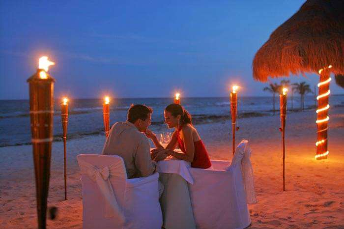 A couple enjoying a candlelight dinner on the Palolem beach