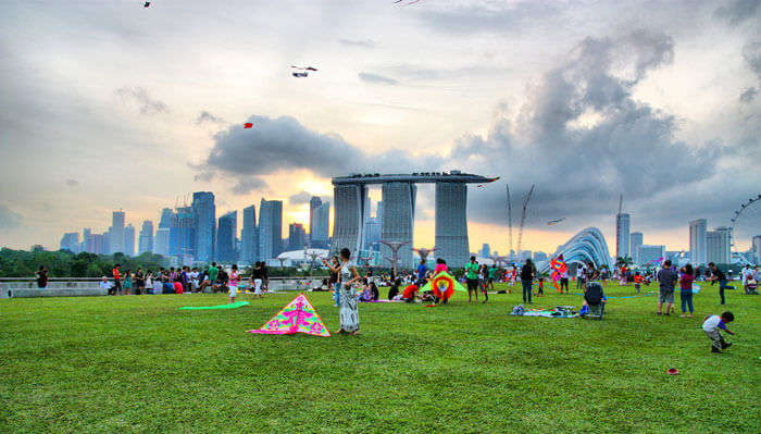 Among exciting things to do in Singapore for free is flying kites at Marina Barrage