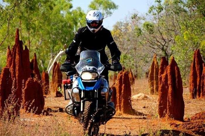 A rider driving through Australian terrains