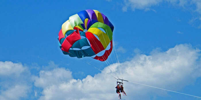 Two women enjoying parasailing in Uttarakhand – one of the most popular parasailing spots in India