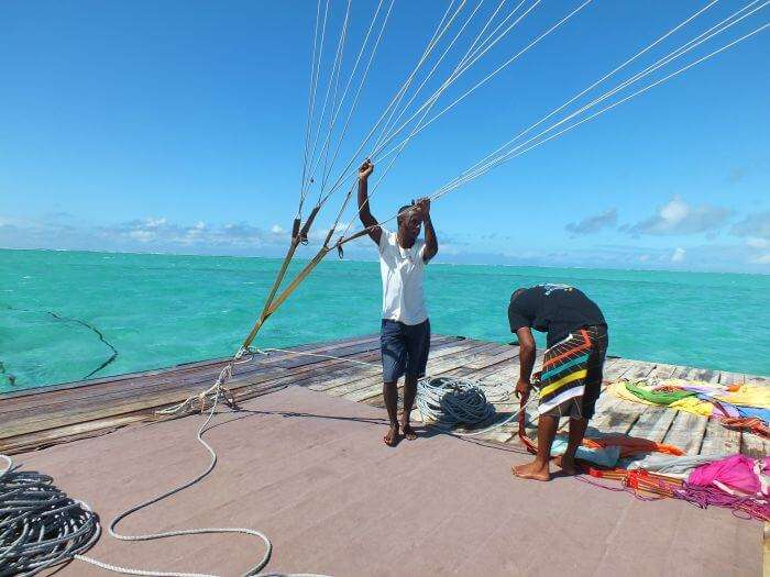 Two men getting ready for platform parasailing