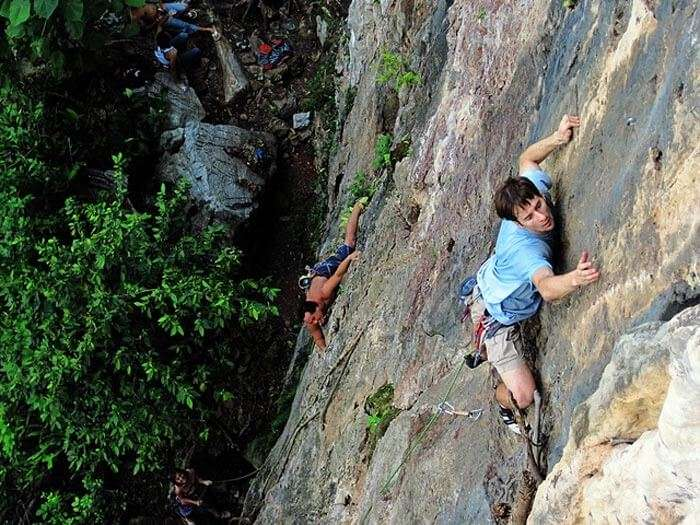 Rock climbing at Batu caves - an adventurous spot among all the top places to visit in Malaysia